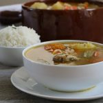 white and brown bowls of Spanish Style Beef Soup
