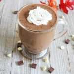 a cup of pumpkin spice hot chocolate with whipped cream on top