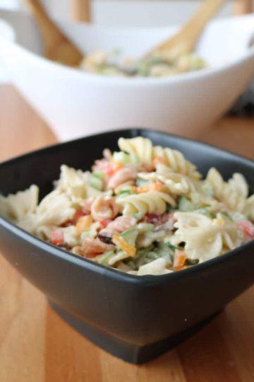 Two bowls of vegetarian pasta salad