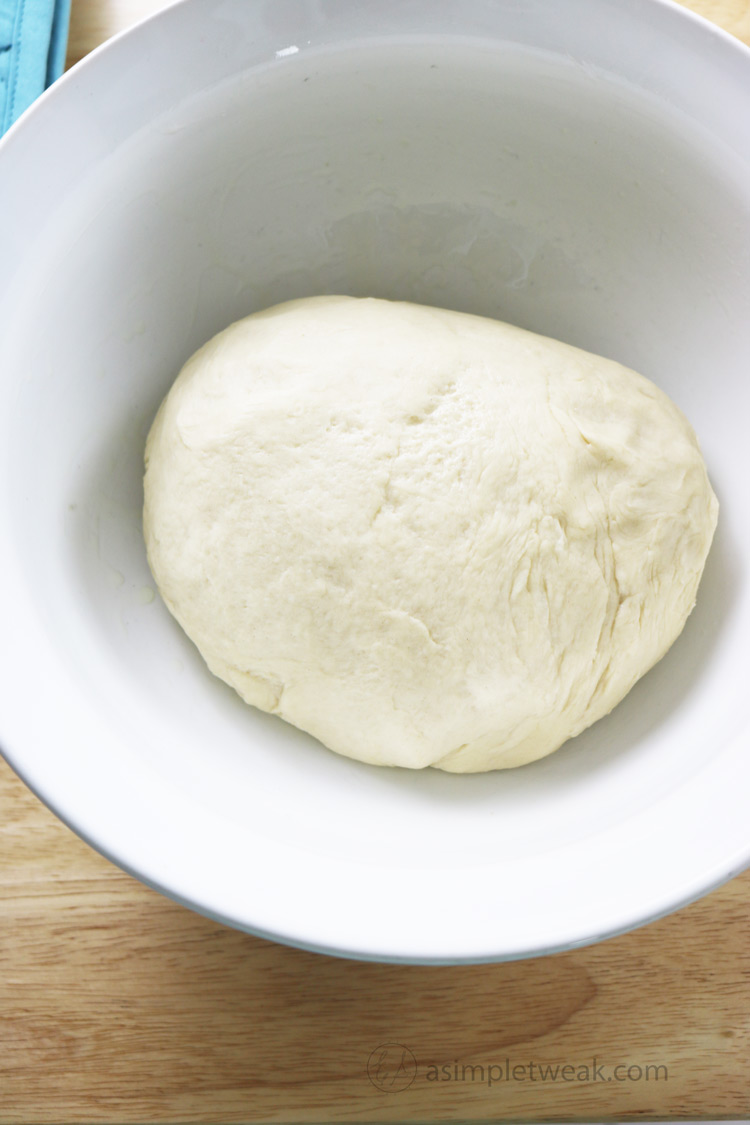 Place-the-dough-in-a-large-bowl