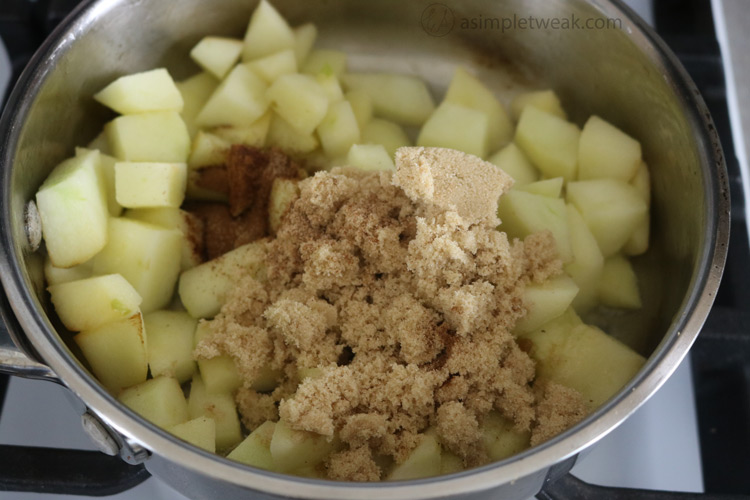 Add the apples, 1/4 cup brown sugar, 1/2 teaspoon cinnamon, 1/2 teaspoon fresh nutmeg, and a pinch of salt and reduce the heat to low.