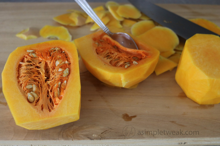 Use-a-spoon-to-scoop-out-the-butternut-squash-seeds