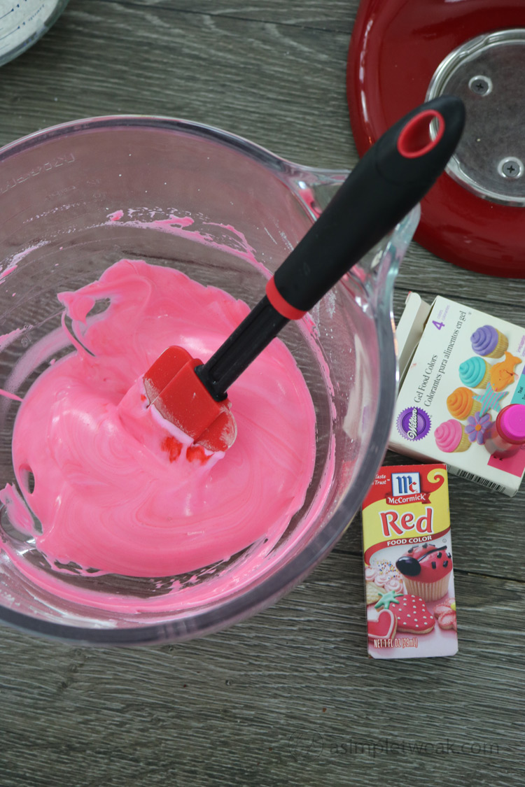 Add-red-or-pink-gel-food-coloring-into-the-meringue-mixture-and-fold-with-spatula