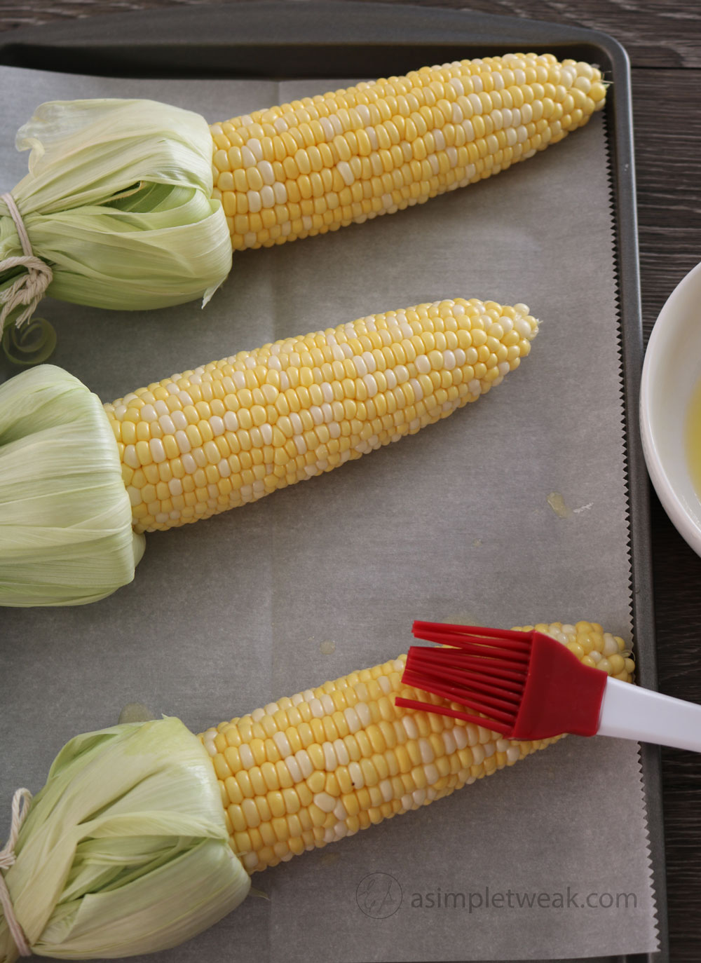 Brush-the-corns-with-unsalted-butter