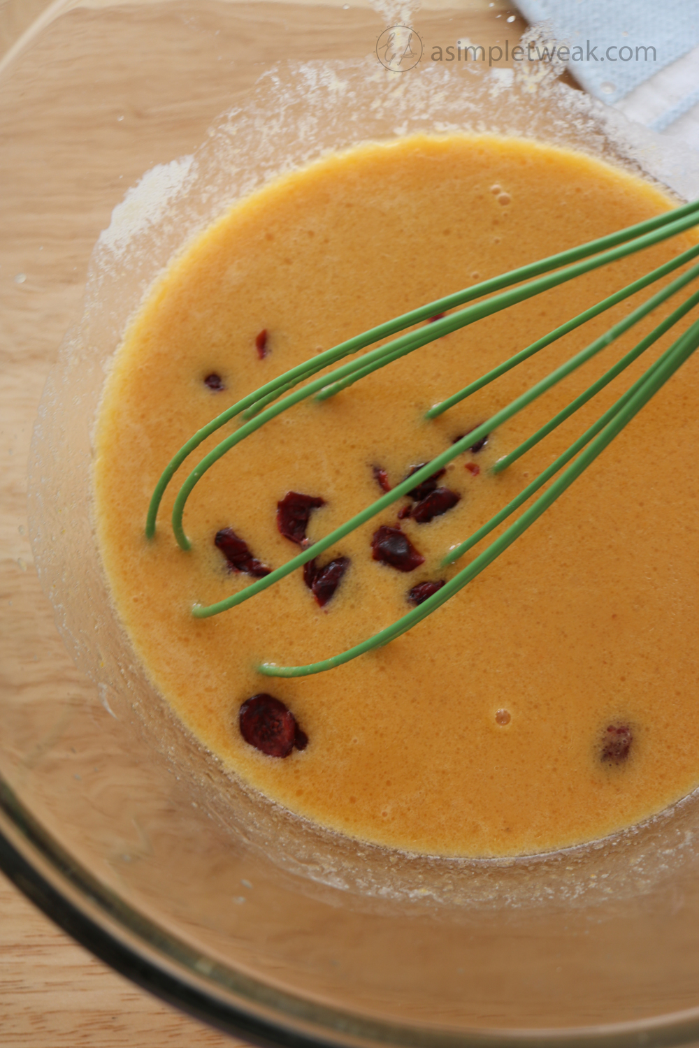 Add the pumpkin puree, an egg, milk, unsalted butter, and vanilla extract in the yeast mixture—Wisk to combine.